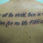 script lettering cursive back tattoo