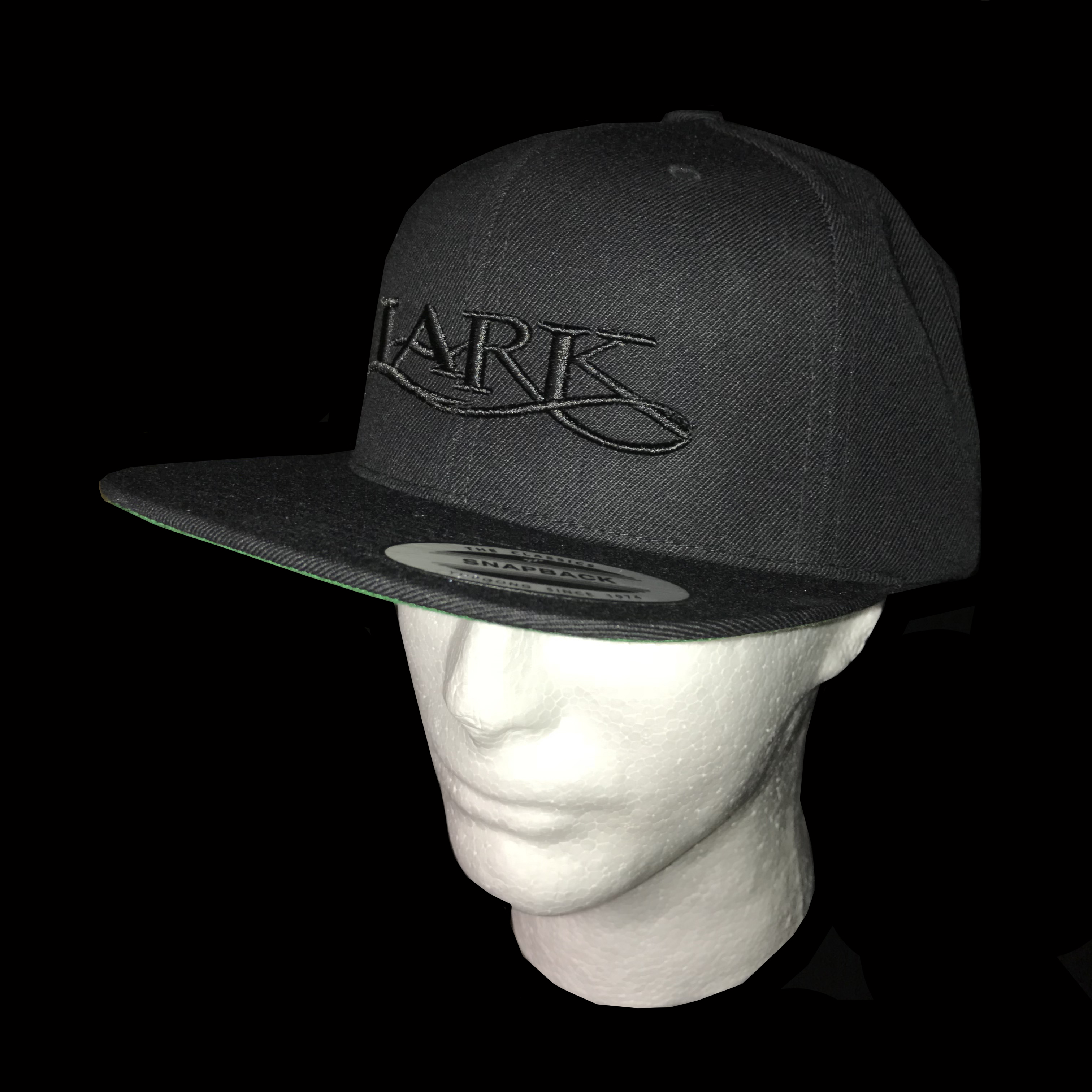 8053ce524 $25.00: Lark Fancy Lettering on Snapback Baseball Cap - Colors: black  embroidery on black colored hat