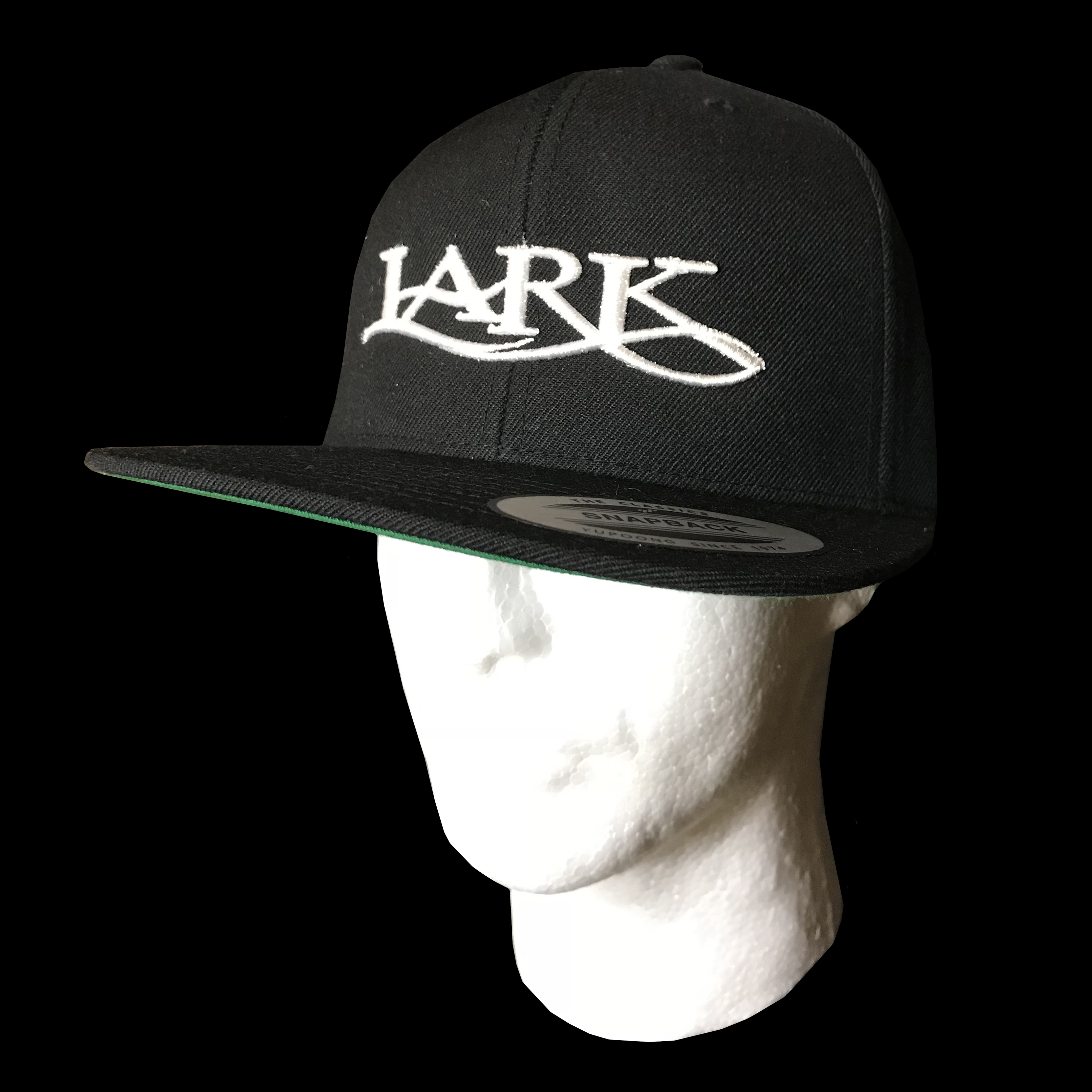 8140b12effdb1  25.00  Lark Fancy Lettering on Snapback Baseball Cap – Colors  white  embroidery on black colored hat